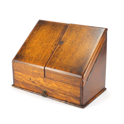 30 - Victorian oak slope front stationery box, with fitted interior and base drawer, 29cm H x 37.5cm W x ...