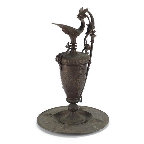 17 - 19th century cast iron Neoclassical design ewer on stand, cast with classical figures, urns and foli...
