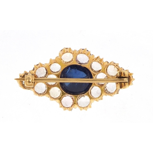 708 - Unmarked gold white sapphire cluster brooch set with a central cabochon blue sapphire, 2.8cm wide, a...