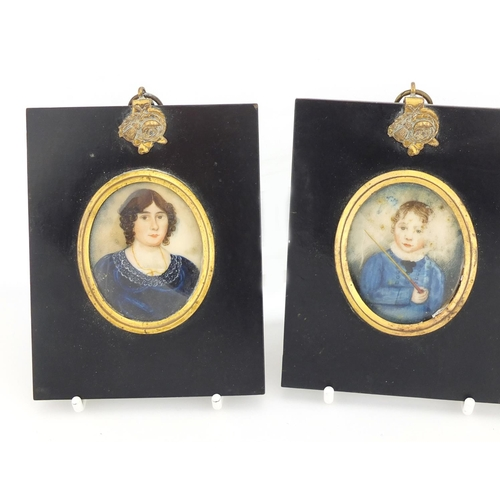 34 - Three 19th century oval hand painted portrait miniatures comprising a male, female and child, each m...