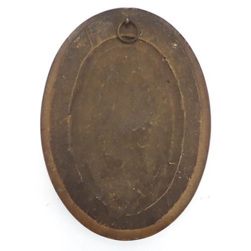 16 - Oval patinated bronze plaque cast with a mother and children, framed, 11.5cm x 7cm...