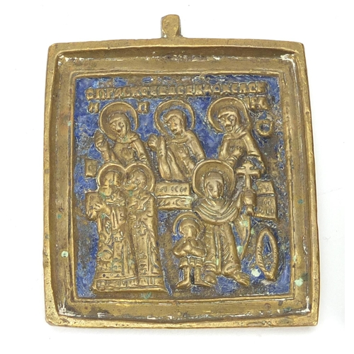 56 - Russian brass and enamel icon and a door knocker, the largest 14.5cm in length...