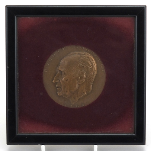 36 - Commemorative bronze medal of Robert Soupault, label verso, mounted and framed, 6.7cm in diameter...