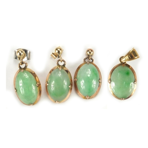655 - Unmarked gold cabochon green jade pendant, matching earrings and one other, the pendant 2.1cm in len...