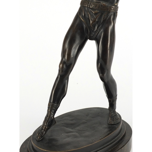 4 - R Abraham - Patinated bronze model of a Grecian Warrior, raised on an oval marble base, 33cm high...