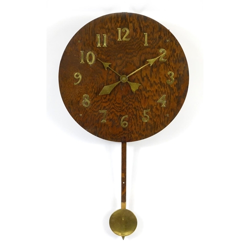 2017 - American Arts & Crafts oak wall clock by the New Haven Clock Co, with applied brass Arabic numerals,...