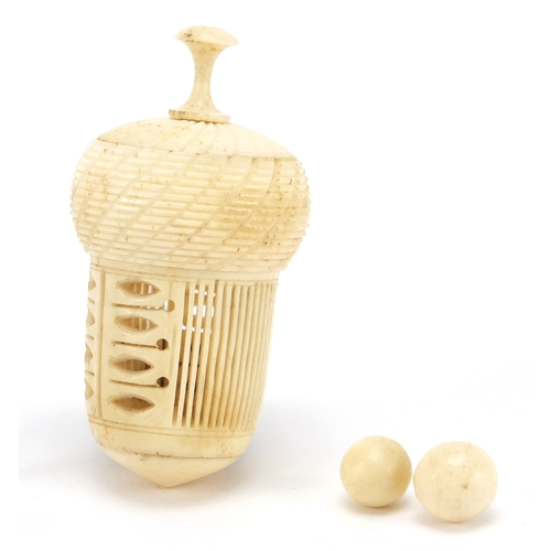 59 - 19th century bone acorn thimble case and a set of miniature bone skittles with two balls, the larges...