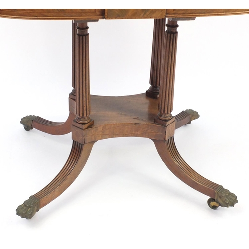 2002 - Regency inlaid walnut fold over card table, raised with quadruple fluted columns with brass paw feet...