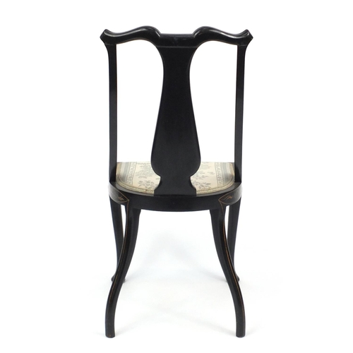 2026 - Black lacquered chinoiserie occasional chair, hand painted and gilded with a figure in a landscape, ...