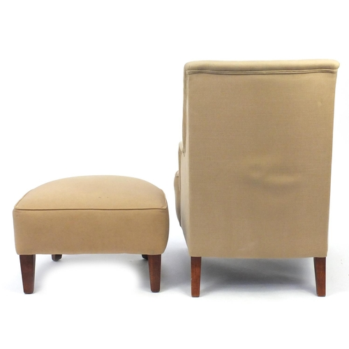 2055 - Contemporary beige high back open armchair with stool on square tapering legs, 103cm high...