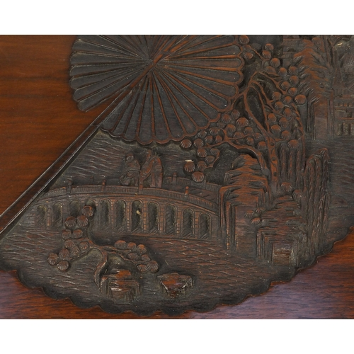 2046 - Chinese camphor wood blanket box, carved with figures and landscapes in fan cartouches, the interior...