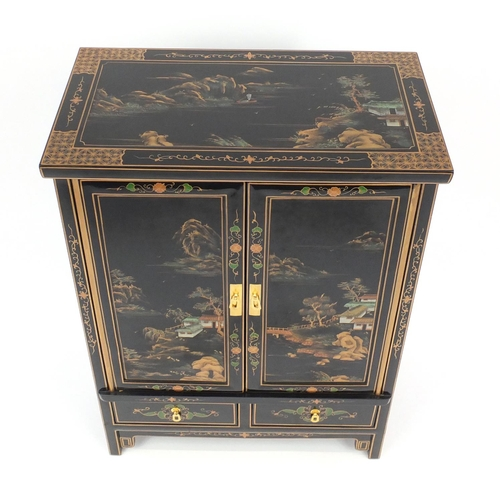 2027 - Black lacquered chinoiserie cabinet, fitted with a pair of cupboard doors above to base drawers, 93c...