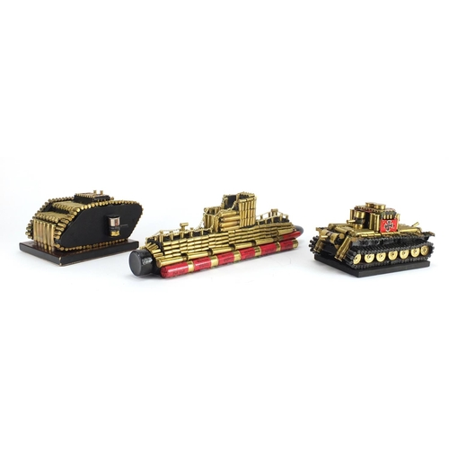 554 - Two trench art style tanks and a boat, the largest 42.5cm in length...