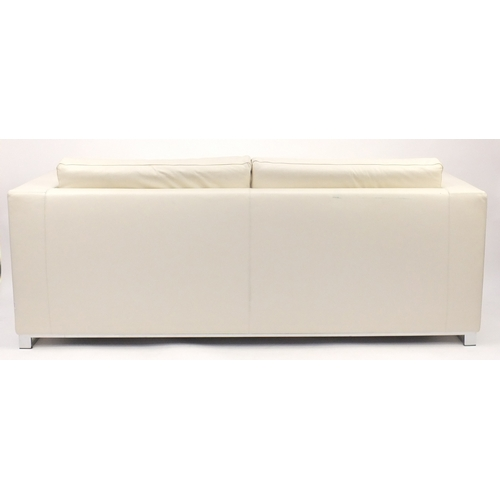2024 - Contemporary Habitat cream leather sofa bed with chrome feet, 70cm H x 196cm W x 82cm D...