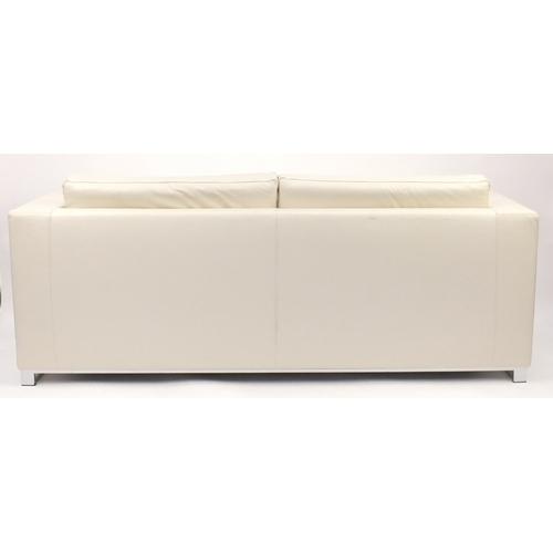 2053 - Contemporary Habitat cream leather sofa bed with chrome feet, 70cm H x 196cm W x 82cm D...