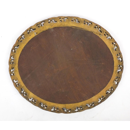 20 - Large oval gilt framed mirror, with bevelled glass, 97cm x 83cm...