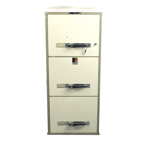 21 - Remington Rand industrial three drawer industrial fire safe, 126.5cm H x 51.5cm W x 75.5cm D...
