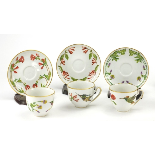 205 - Set of six tea cups and saucers by Franklin porcelain with display stands, decorated with Hummingbir...