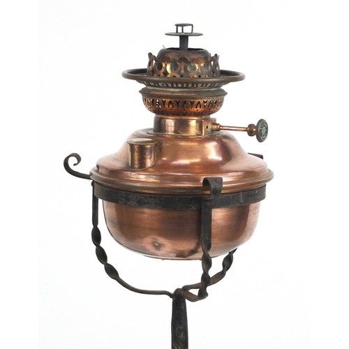 50 - Arts & Crafts telescopic wrought iron and copper standard oil lamp, 148cm high...