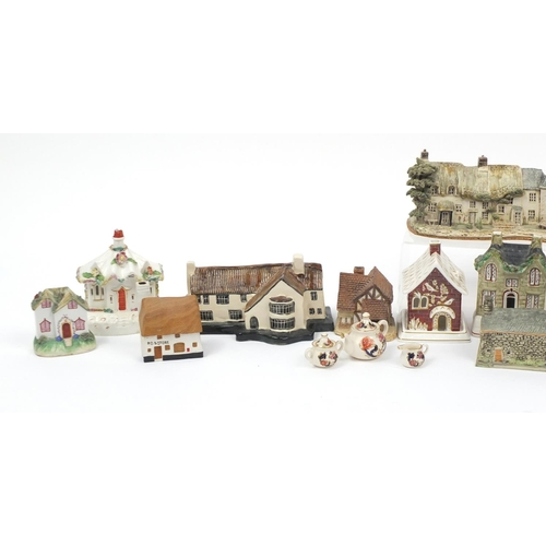 249 - Model buildings and cottages including a Coalport pastille burner and Staffordshire china...