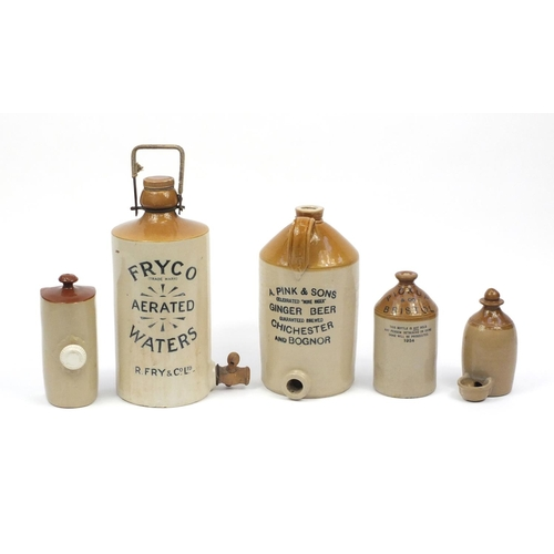 297 - Five stoneware advertising flagons and bottles including Fry Co and Pink & Sons, the largest 26cm hi...