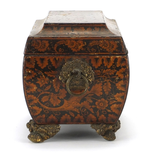 32 - Regency penwork sarcophagus tea caddy, the hinged lid opening to reveal a lidded twin divisional int...