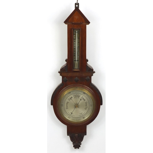 48 - Mahogany aneroid barometer with silvered dial, 90cm in length...