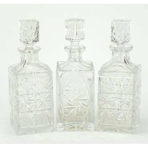 140 - Pair of cut crystal decanters with stoppers and one other, 27cm high...
