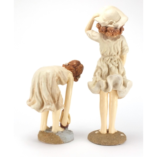 162 - Two decorative figurines of young girls at the seaside, the largest 45cm high...