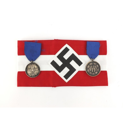 994 - Two German style Military interest medals and an armband...