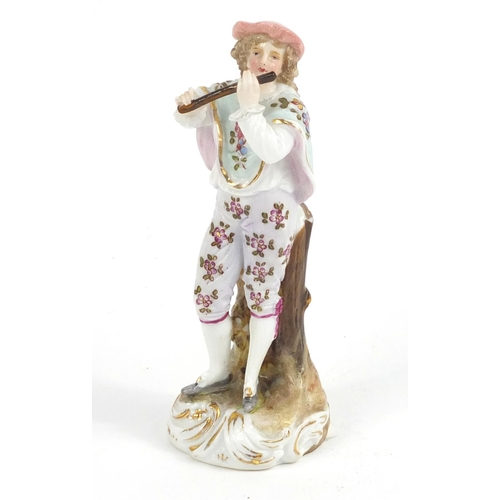 414 - 19th century German porcelain figure playing a flute, 10.5cm high...