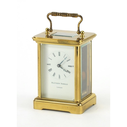 146 - Matthew Norman brass cased carriage clock, with swing handle and bevelled glass, 11cm high...