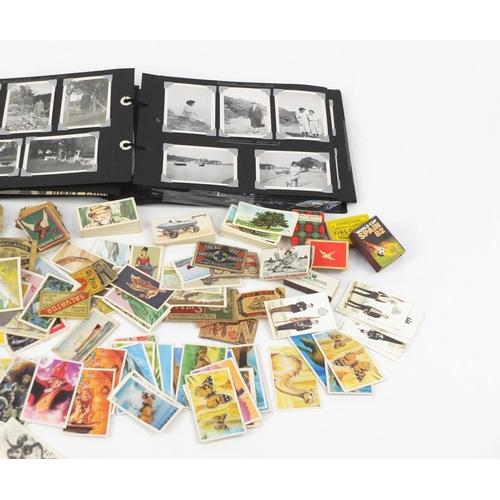 955 - Ephemera including vintage black and white photographs, porcelain scent bottles, tea cards, cigarett...