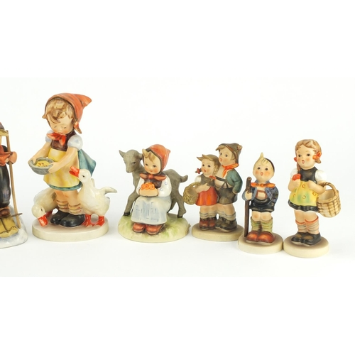 2105 - Ten Goebel hand painted figures including Good Friends and Trumpet Boy, the largest 16cm high...