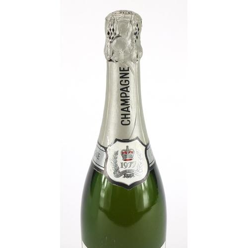 2048 - Bottle of Augustus Barmett Queen's Silver Jubilee champagne...