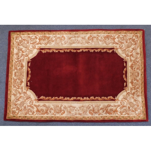 41 - Red and cream ground floral rug, 180cm x 124cm...
