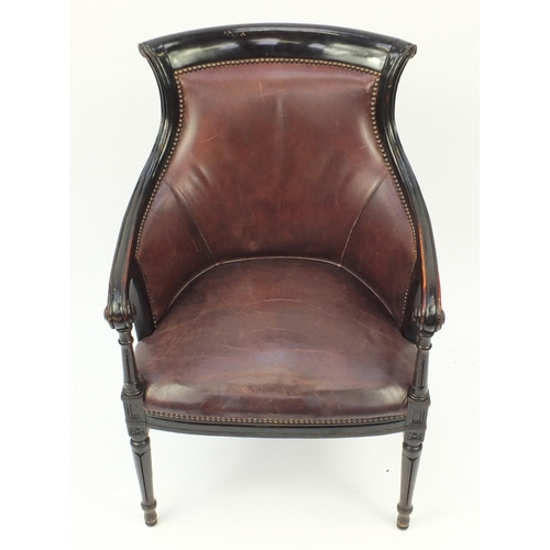 2005 - Mahogany and brown leather library chair on tapering legs, 91cm high...