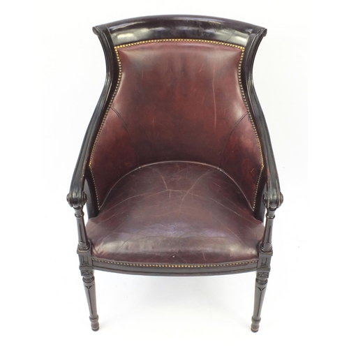 2012 - Mahogany and brown leather library chair on tapering legs, 91cm high...