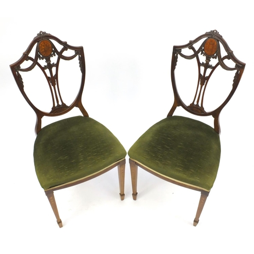 2024 - Pair of inlaid mahogany shield back occasional chairs with green stuff over seats, raised on square ...