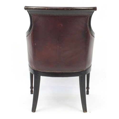 2022 - Mahogany and brown leather library chair on tapering legs, 91cm high...
