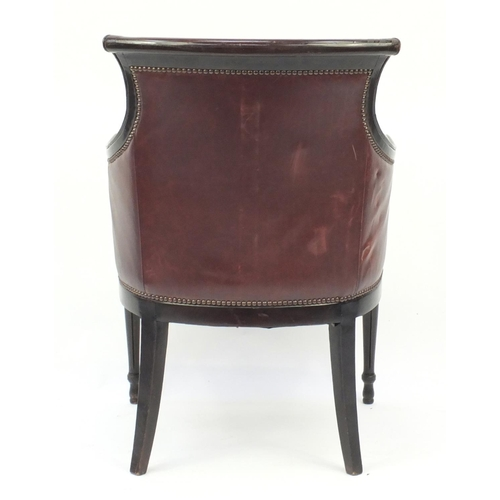 2026 - Mahogany and brown leather library chair on tapering legs, 91cm high...
