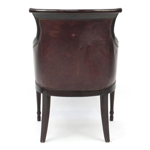 2027 - Mahogany and brown leather library chair on tapering legs, 91cm high...