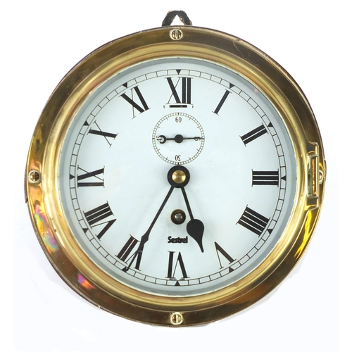 2209 - Sestrel brass ships bulk head clock, with subsidiary dial and Roman numerals, 20.5cm in diameter...