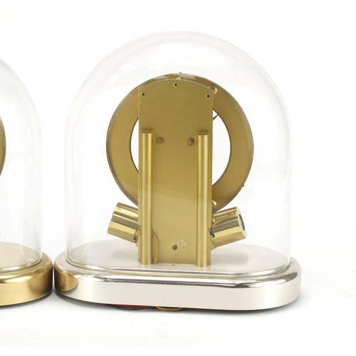 2205 - Two Junghans Anticlimatic electronic mantel clocks with glass domes, each 23.5cm high...