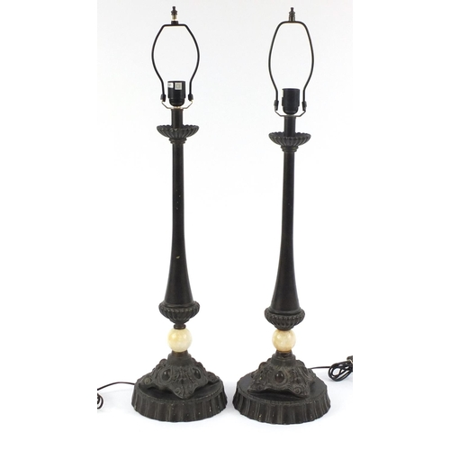 2031 - Pair of large bronzed and alabaster lamps, each 74cm high excluding the fittings...