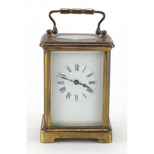 2096 - Brass cased carriage clock with enamelled dial and Roman numerals, 11cm high...