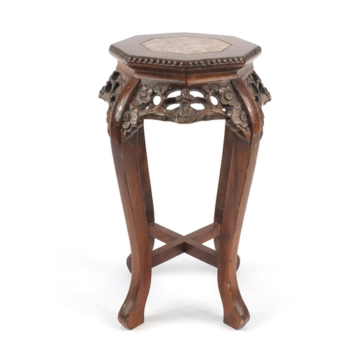 2025 - Chinese octagonal hardwood stand with inset marble top, carved and pierced with flowers, 60.5cm high...