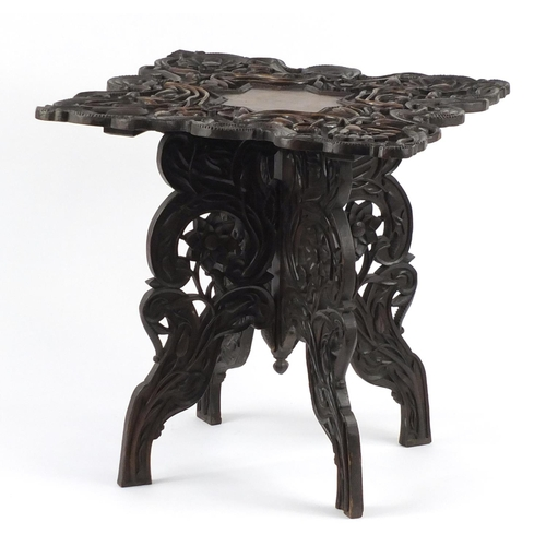 2007 - Anglo Indian folding hardwood table, profusely carved and pierced with flowers, 66cm H x 64.5cm W x ...
