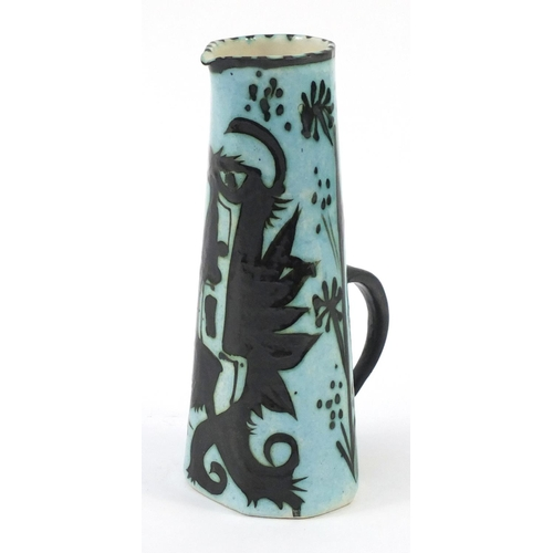 423 - Celtic pottery jug hand painted with a phoenix, 29cm high...