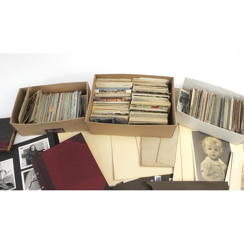 976 - Ephemera including Edwardian and later postcards, black and white photographs, stamps and greetings ...